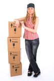 Jeune femme avec une pile de colis images stock