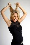 Jeune femme blond dans la fureur Photographie stock