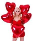 Jeune femme blonde avec des ballons pour le jour de Valentines Images stock