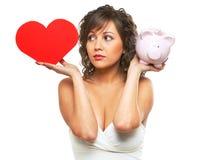 Jeune femme chosing entre l'amour et l'argent Images stock