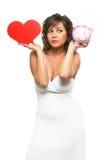 Jeune femme chosing entre l'amour et l'argent Photo libre de droits