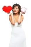 Jeune femme chosing entre l'amour et l'argent Image libre de droits