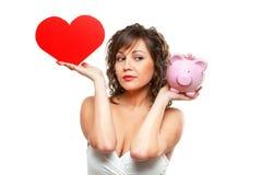 Jeune femme chosing entre l'amour et l'argent Image stock