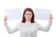Jeune femme confuse Photo stock
