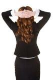 Jeune femme d'affaires avec des mains derrière la tête Photo libre de droits