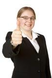 Jeune femme d'affaires avec des pouces vers le haut Photographie stock libre de droits