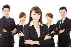 Jeune femme d'affaires avec l'équipe réussie d'affaires Photo libre de droits