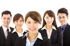Jeune femme d'affaires avec l'équipe réussie d'affaires Images libres de droits