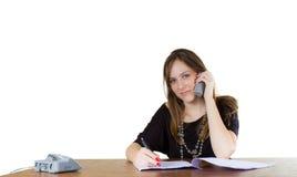 Jeune femme d'affaires dans un bureau photos stock