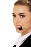Jeune femme d'affaires de sourire avec le casque Image libre de droits