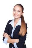 Jeune femme d'affaires de sourire d'isolement sur le blanc Image stock