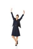 Jeune femme d'affaires heureuse avec des mains vers le haut Images stock