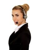 Jeune femme d'affaires heureuse avec le casque Images libres de droits