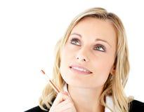 Jeune femme d'affaires pensive regardant vers le haut photos libres de droits