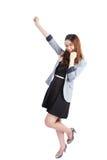 Jeune femme d'affaires réussie célébrant la réussite Images stock
