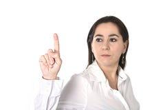 Jeune femme d'affaires réussie indiquant avec le doigt l'espace de copie Image stock