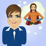 Jeune femme d'affaires rêvant de l'homme de super héros illustration libre de droits