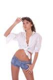Jeune femme dans des circuits de jeans photographie stock