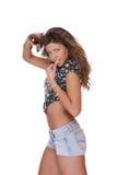Jeune femme dans des circuits de jeans photos stock