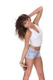 Jeune femme dans des circuits de jeans photo libre de droits