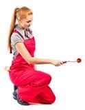 jeune femme dans des combinaisons rouges avec des outils de peinture images stock image 27588794. Black Bedroom Furniture Sets. Home Design Ideas