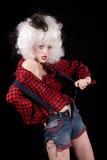 Jeune femme dans l'équipement du Mid-West sexy Image stock