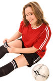 Jeune femme dans l'uniforme du football images stock