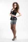 Jeune femme dans la jupe courte Image libre de droits