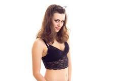 Jeune femme dans la lingerie noire Photographie stock libre de droits