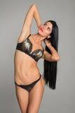Jeune femme dans la lingerie recherchant Photos stock