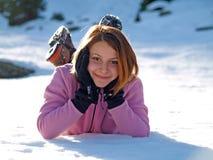 Jeune femme dans la neige Photographie stock