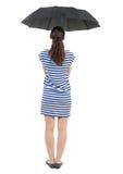 Jeune femme dans la robe sous un parapluie Photos libres de droits
