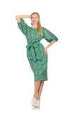 Jeune femme dans la robe verte d'isolement sur le blanc Photos stock