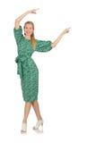 Jeune femme dans la robe verte d'isolement sur le blanc Image stock