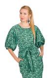 Jeune femme dans la robe verte d'isolement sur le blanc Image libre de droits