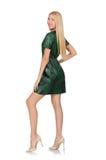 Jeune femme dans la robe verte d'isolement sur le blanc Photo stock