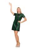 Jeune femme dans la robe verte d'isolement sur le blanc Photographie stock