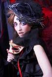 Jeune femme dans le noir Images stock