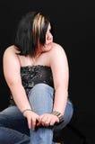 Jeune femme dans le studio. Photo stock