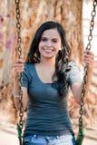 Jeune femme dans une oscillation Photographie stock libre de droits