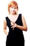 Jeune femme de beauté avec du vin sur la réception Image libre de droits