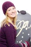 Jeune femme de beauté avec le snowboard Image libre de droits