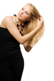 Jeune femme de beauté dans la robe noire Photographie stock