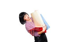 Jeune femme de brunette avec des sacs à provisions Images libres de droits