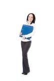 Jeune femme de bureau tenant des dossiers de document sur le fond blanc Photo libre de droits