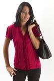 Jeune femme de carrière confiante avec le sac à main Images stock