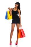Jeune femme de couleur avec des sacs à provisions photo libre de droits