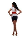 Jeune femme de couleur restant par derrière la courroie rouge Image stock