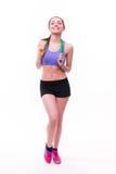 Jeune femme de forme physique avec le chiffre sportif sain avec la corde à sauter photos libres de droits