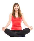 Jeune femme de forme physique faisant des exercices de yoga d'isolement sur le fond blanc Image stock